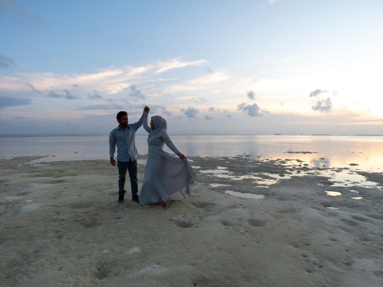 Newlywed couple on the beach at sunset in Vaadhoo